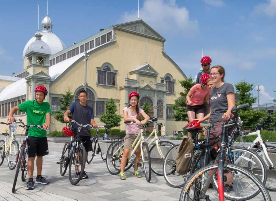 Young guests stop to rest and learn at Lansdowne park landmark, Aberdeen pavilion to during best of Ottawa bike tour with Escapes