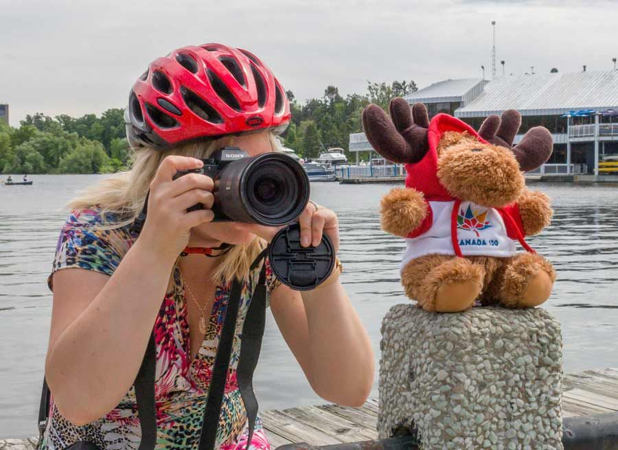A guest is taking a picture at Dow's Lake during a private best of Ottawa day tour by bike in Ottawa by Escape on Sparks