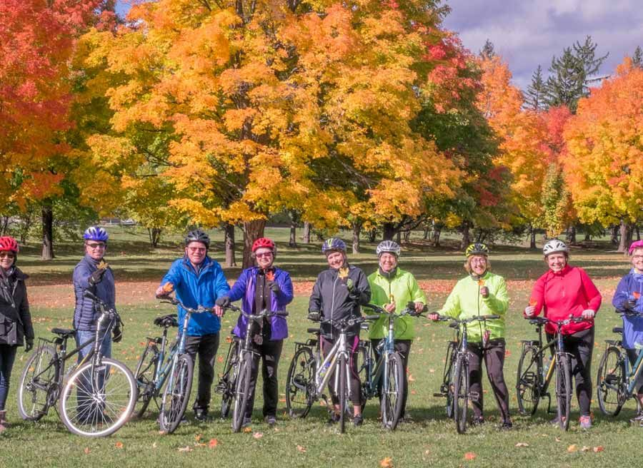Tour guests watching Fall tree colours in Jacque cartier park during best of Ottawa day tour by bike by Escape on Sparks