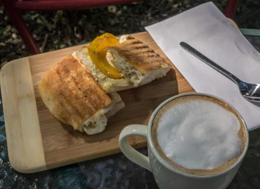 Lunch stop at a local cafe with panini sandwich and Cappuccino during best of Ottawa day tour by bike by Escape on Sparks