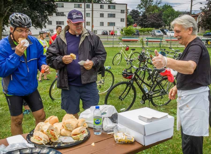 Corporate group is having picnic and eating locally made sandwiches at Little Italy during Escape private bike and food tour