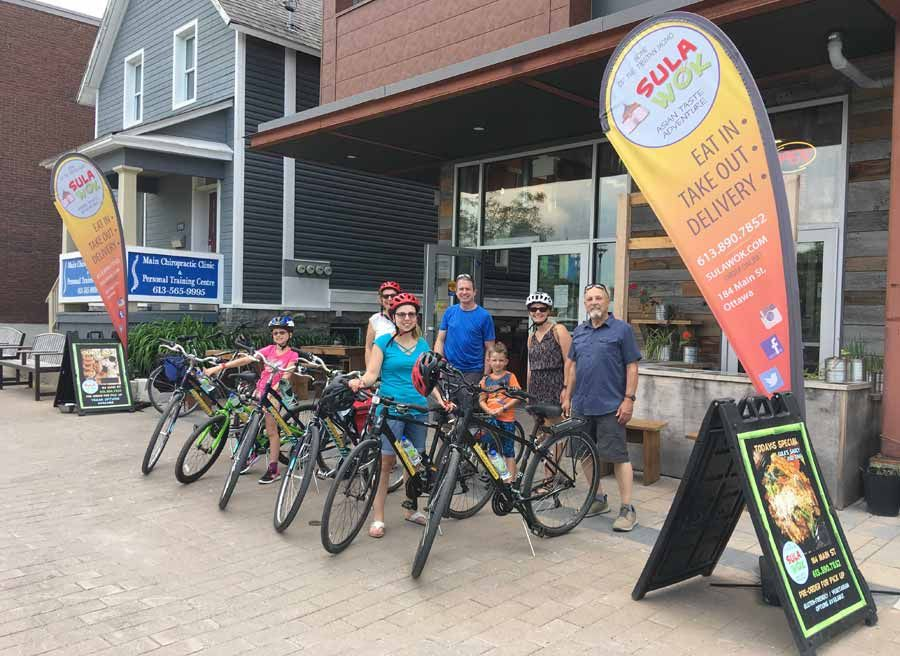Guest sample delicious tacos at Old Ottawa East local eatery during bike and food tour of Ottawa with Escape Tours rentals