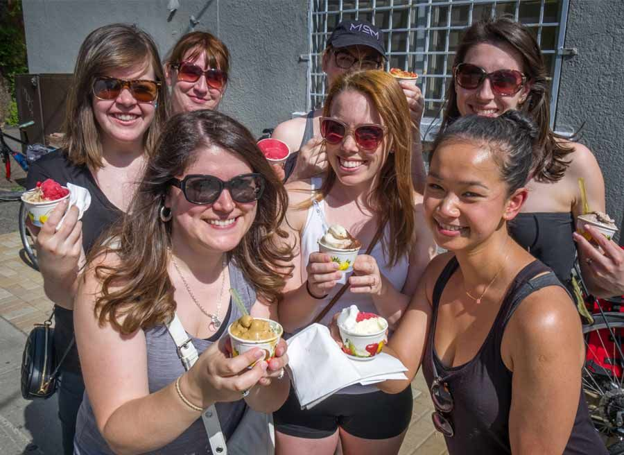 A group of girlfriends having a bachelorette party eating artisan ice cream during Escape bike and food tour in Ottawa