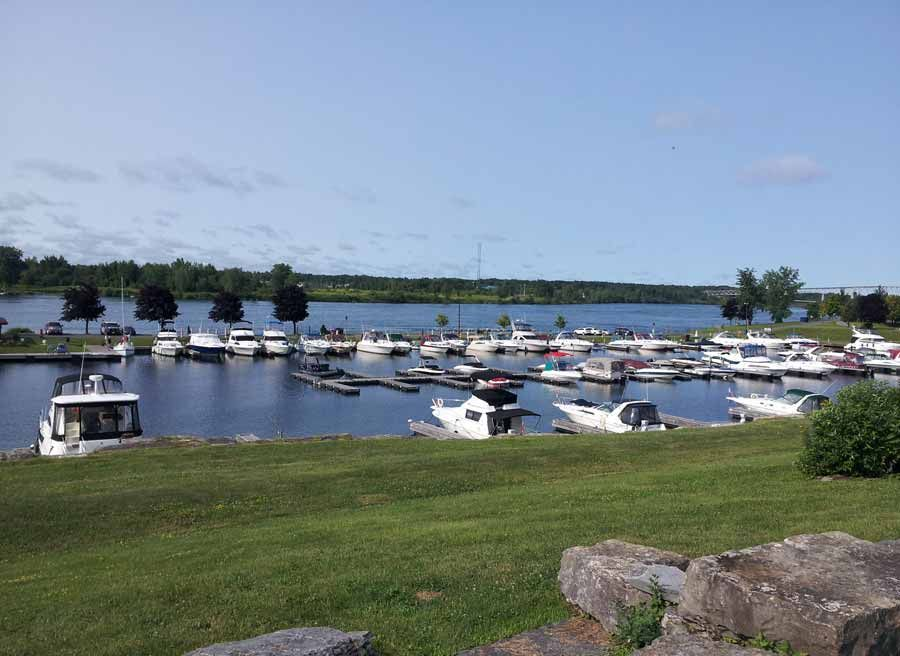 View of St. Lawrence River Marina & boats at Upper Canada Village during Cornwall multi-day bike tour by Escape tours rentals