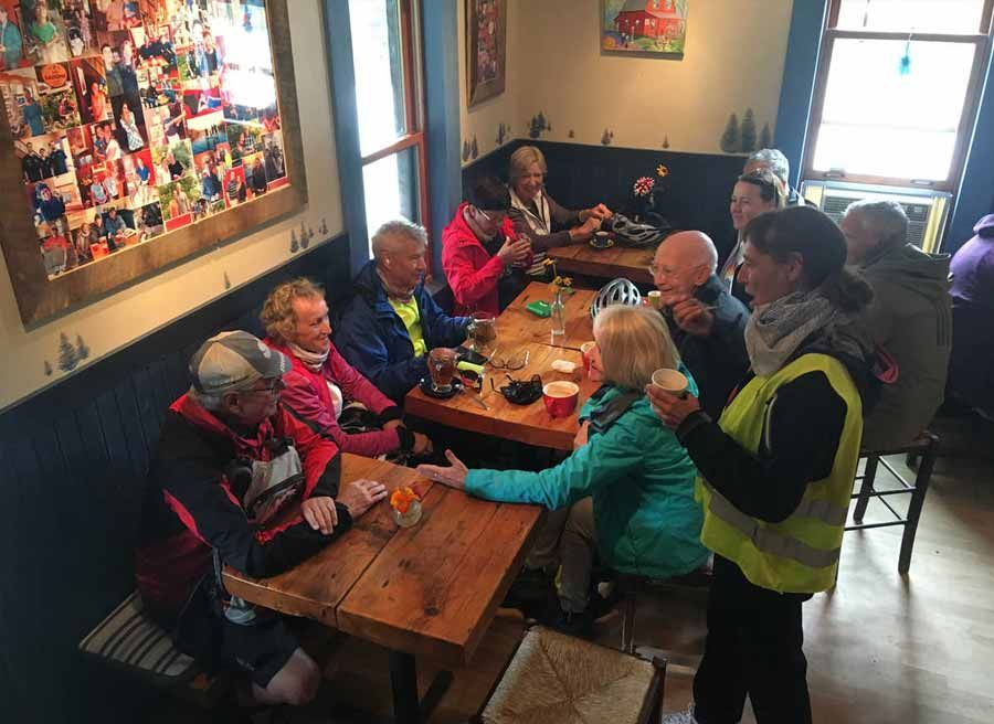 Guests are having lunch at a local cafe during Ottawa multi-day cycling tour by Escape tours rentals on Sparks