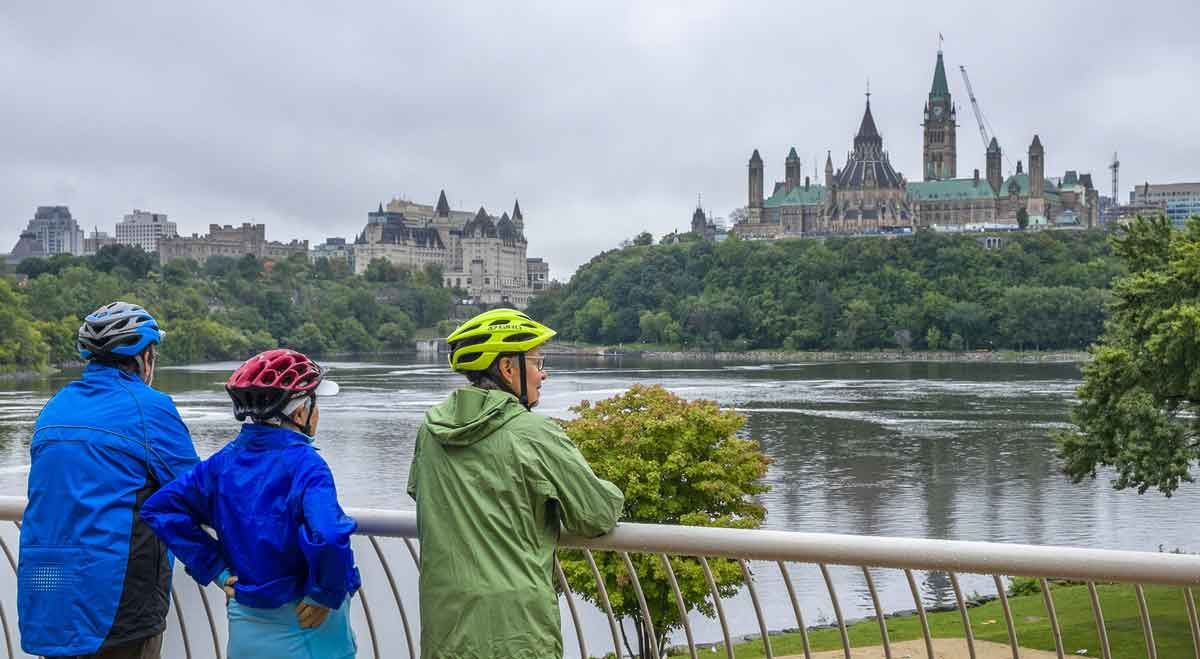 Guests enjoy the parliament building view form the Museum of History look out during their Escape Ottawa bike tour